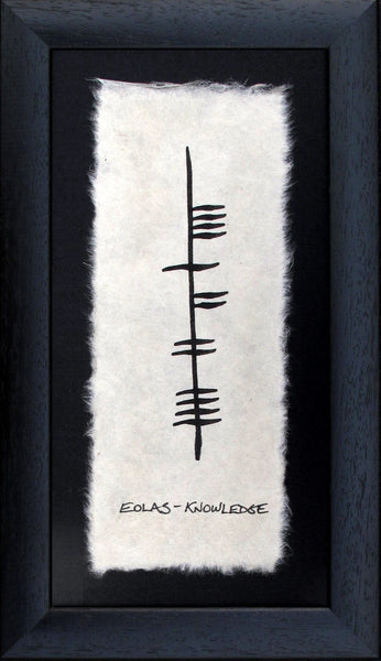 Contained in a black wooden frame is a piece of parchment with ancient irish writing Ogham decaring knowledge eolas Designed and handmade in Ireland