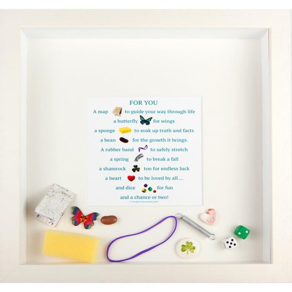 For you box frame is a white frame that contains a verse and various small items that are loose in the frame to commemorate an event like a birthday Graduation or someone special who os leaving a job or the country