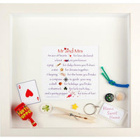 This white wooden frame, contains a poem and various small items to commemorate an event, in this case a wedding or an anniversary.  Designed by Pippa Sweeney and made in Ireland.