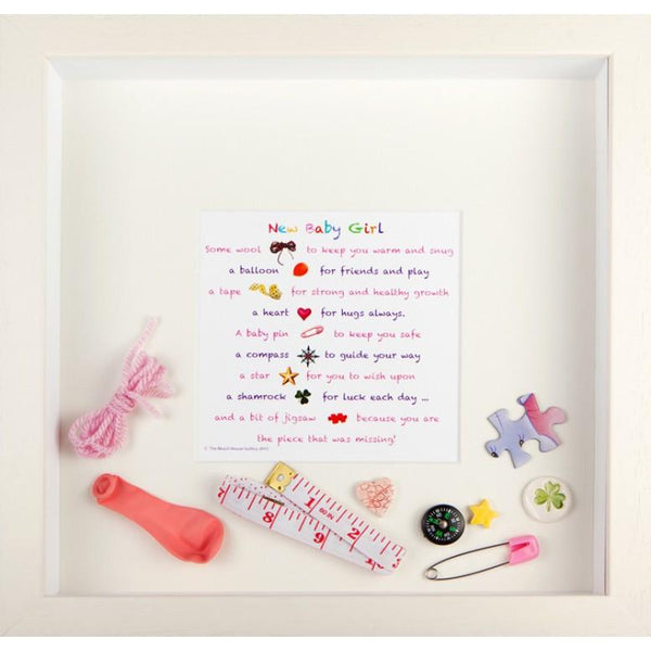 New baby girl frame is a white frame and contains a poem and various small pieces that are loose in the box to commemorate an event, in this case the birth of a baby girl Designed by Pippa sweeney and handmade in Ireland