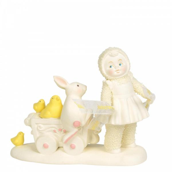 The picture shows a figurine from the snowbaby range she is pulling a small cart with a white rabbit and yellow chicks, entitled springtime express.