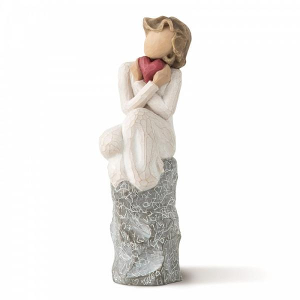 Willow tree always is a figurine of a girl sitting on a signed rock hugging a red heart with crossed arms