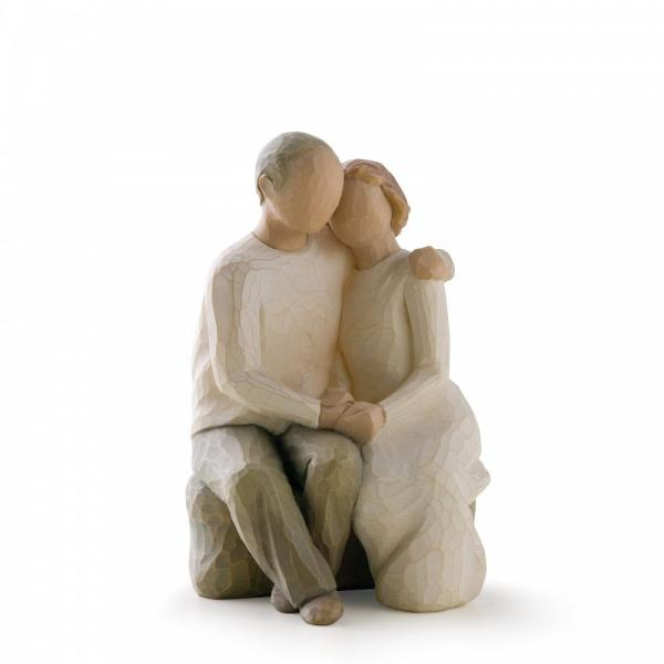 Willow Tree Anniversary 2 figurines sitting on a rock The Man is hugging his wife and she is holding his hand with both her hands