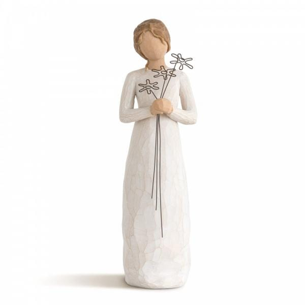Willow tree Grateful is a figurine of a girl standing holding three flowers