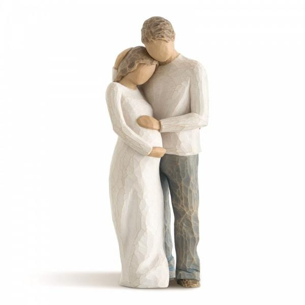 Willow Tree Home is a figurine of two parents to be. The woman is pregnant she is holding her bumb while the father has his hand also resting on the bump