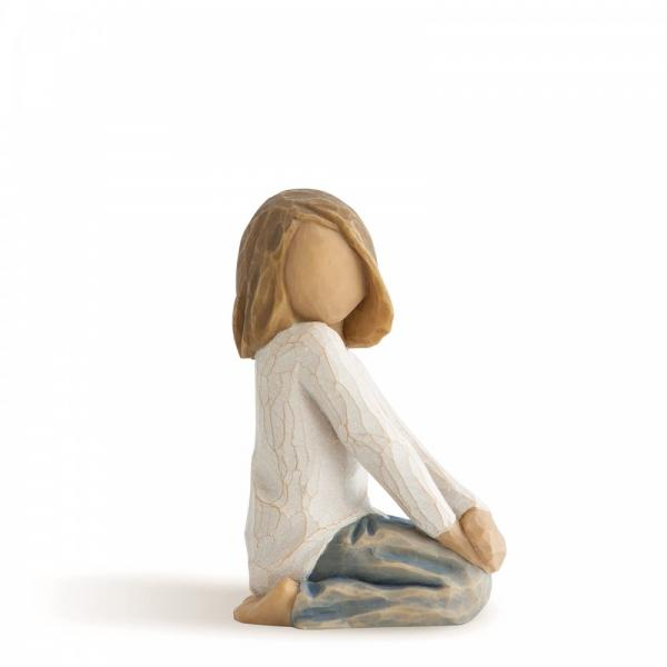 Willow Tree Joyful child is a figurine of a small girl stting on her legs with her hands crossed on her knees