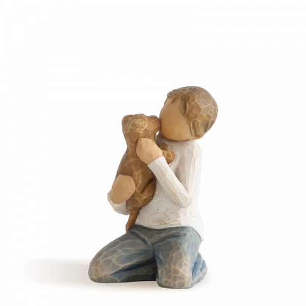 Willow Tree Kindness  is a figurine of a boy kneeling holding a  brown puppy dog
