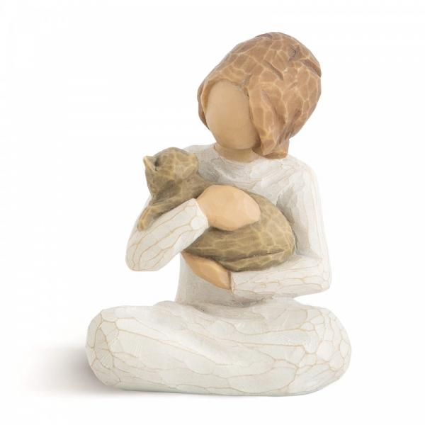Willow Tree Kindness girl  is a figurine showing a young giel sitting cross legged holding a pet cat