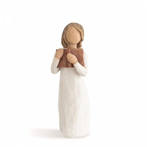 Willow Tree Love of Learning figurine is a girl standing holding a brown book close to her heart