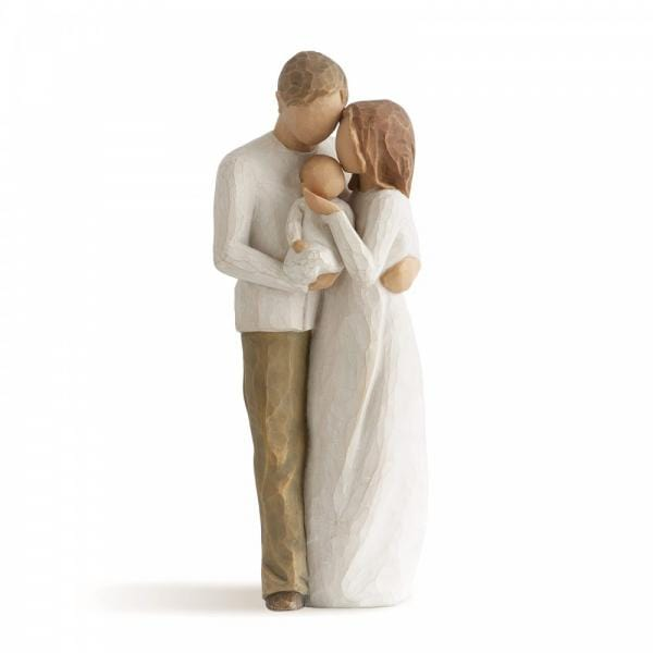Willow Tree Our Gift Is a mother and father figurine  where the father is holding the child and the mother is kissing the child on the head