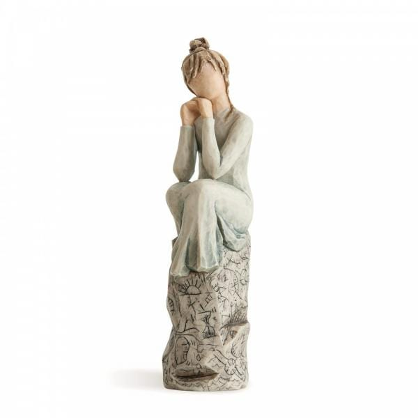 Willow Tree patience is a figurine of a girl sitting on a rock with her hands under her chin thinking