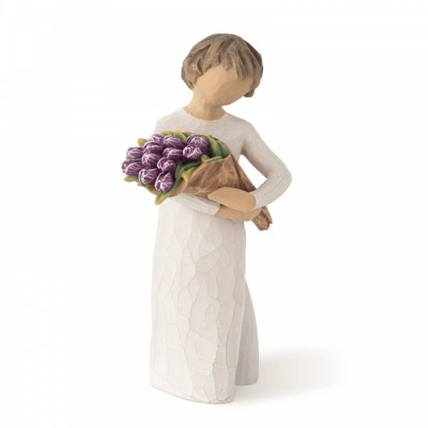 Willow tree Surprise is a figurine of a girl holding a bunch of purple flowers