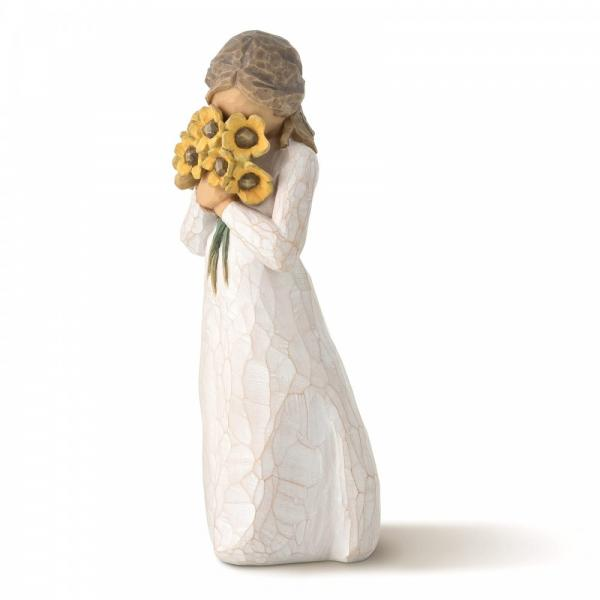 Willow Tree Warm Embrace is a figurine of a girl carrrying and smelling  a bunch of yellow flowers