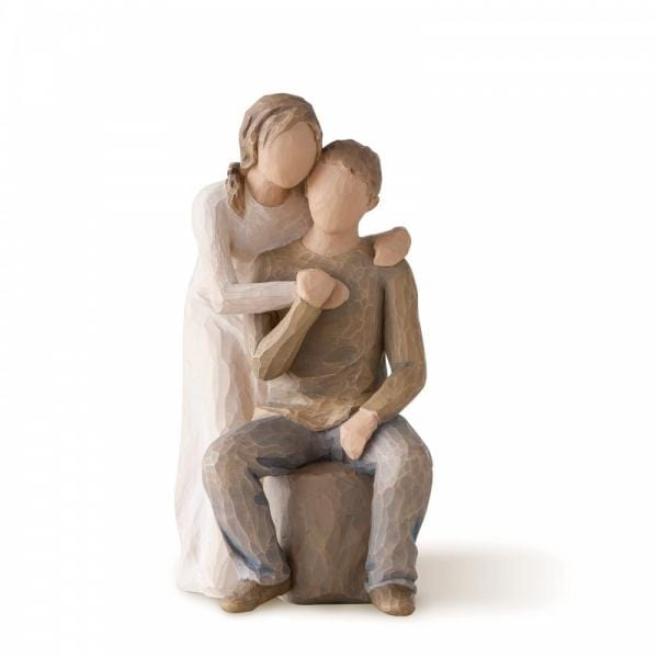 Willow Tree You and Me is a figurine with a Male and female The male is sitting on a rock while the female is leaning over the male with both arms hugging him