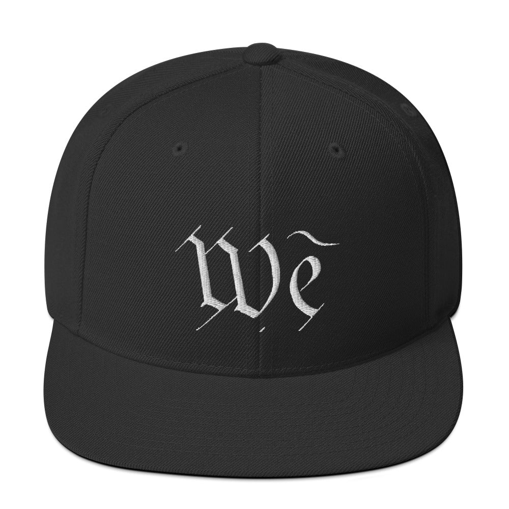 We Snapback Hat by Stephen Glassman