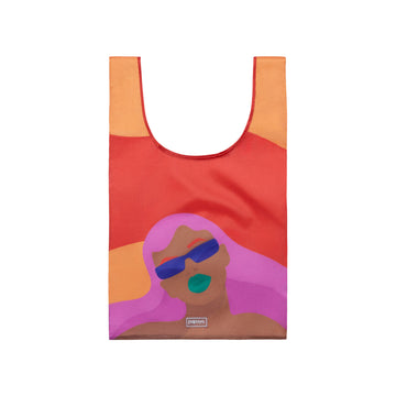 Reusable shopping bag with design of a woman wearing purple sunglasses by artist Laci Jordan