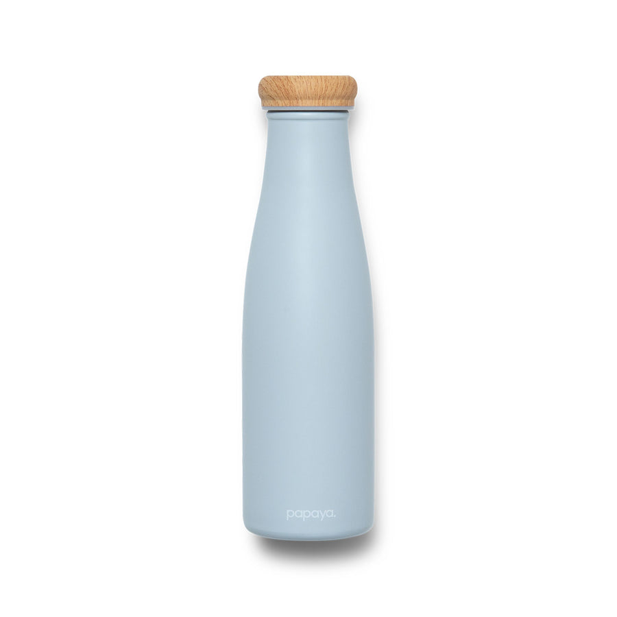 Reusable stainless steel water bottle in soft powder blue with bamboo color cap