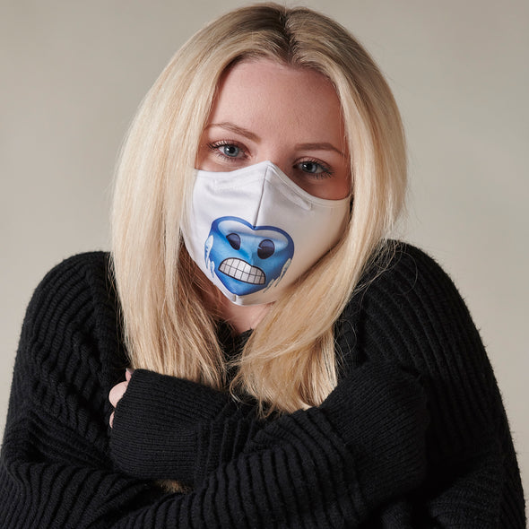 Woman wearing sweater and Rafi Nova x emoji  Adult Superfit mask in blue chill pattern. White Superfit mask with blue round face with icicles on cheeks. White adjustable ear loops.