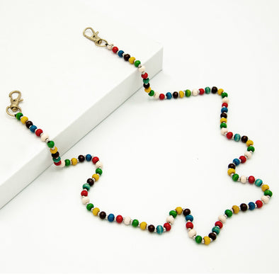 Rafi Nova x Craft Link beaded chain mask holder with red, green, yellow, cream, blue, and black beads.