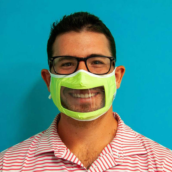 Man wearing Rafi Nova Adult Smile Mask in neon green with white tie behind ear straps.