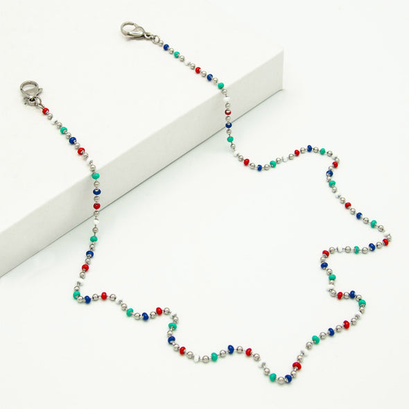 Rafi Nova mask chain with red, silver, white, blue, and turquoise beads. Silver metal attachment clamps.