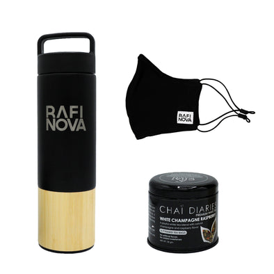 Front view of Rafi Nova xx Welly Water Traveler Bottle, Tea, and Element Mask Set. One Black Water Bottle with a bamboo base, with Rafi Nova logo printed in silver. Side view of One black element mask with black adjustable ear loops. Side view of Chai Diaries tea with champagne raspberry.