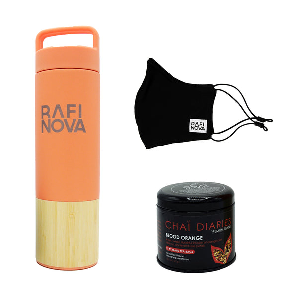 Front view of Rafi Nova xx Welly Water Traveler Bottle, Tea, and Element Mask Set. One coral colored water bottle with a bamboo base, with Rafi Nova logo printed in silver. Side view of One black element mask with black adjustable ear loops. Side view of Chai Diaries tea with blood orange.