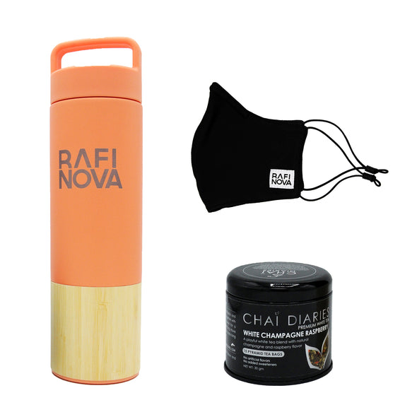 Front view of Rafi Nova x Welly Water Traveler Bottle, Tea, and Element Mask Set. One coral colored water bottle with a bamboo base, with Rafi Nova logo printed in silver. Side view of One black element mask with black adjustable ear loops. Side view of Chai Diaries tea with blood orange.