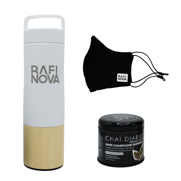 Front view of Rafi Nova x Welly Water Traveler Bottle, Tea, and Element Mask Set. One white colored water bottle with a bamboo base, with Rafi Nova logo printed in silver. Side view of One black element mask with black adjustable ear loops. Side view of Chai Diaries tea with blood orange.