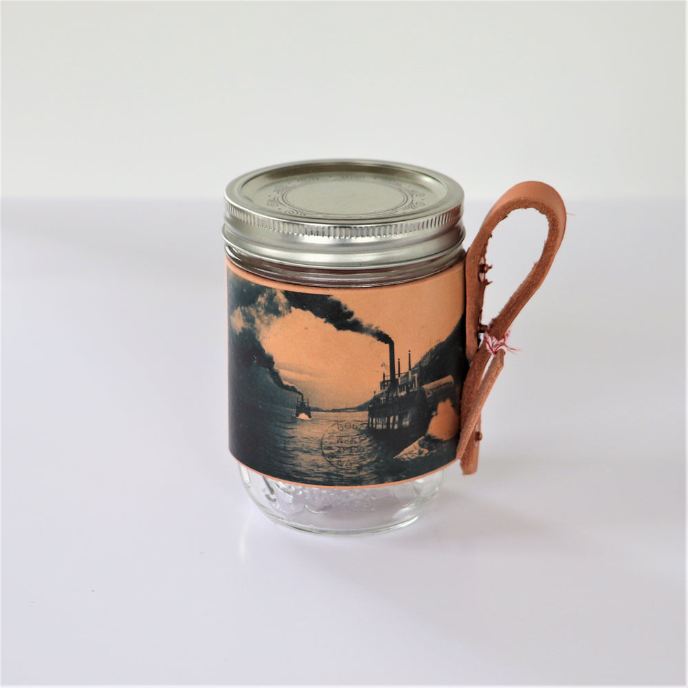 Mason jar sleeve with images from the Touchstones Nelson Archive