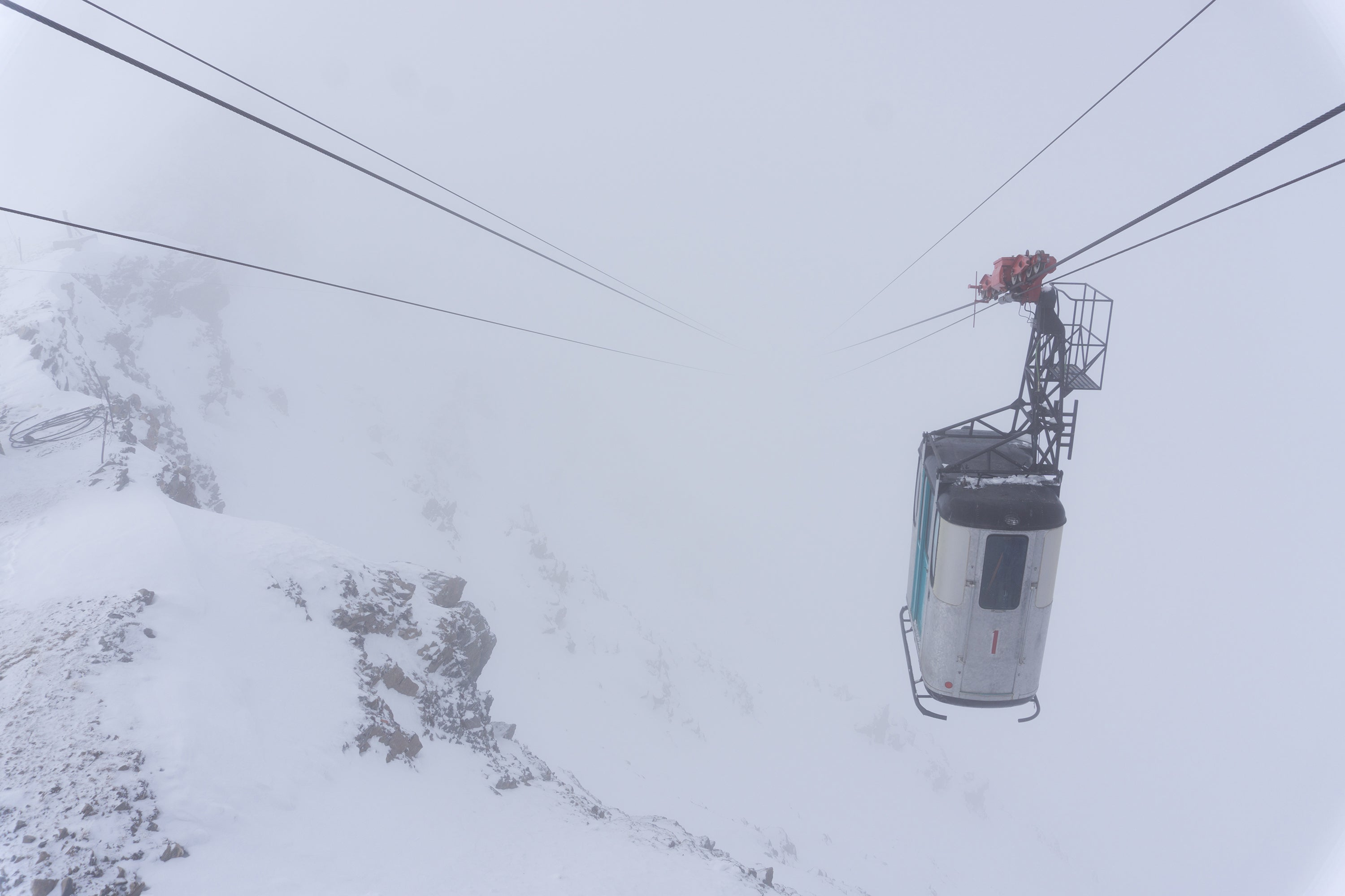 Small skier tram in clouds