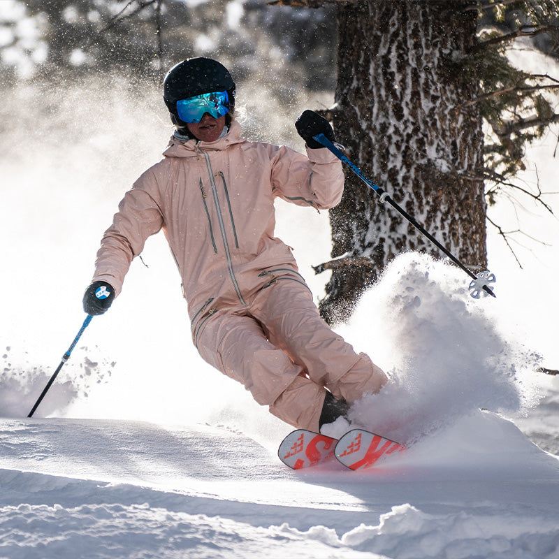 aspen mountain powder turn with skier in peachy sickbed suit
