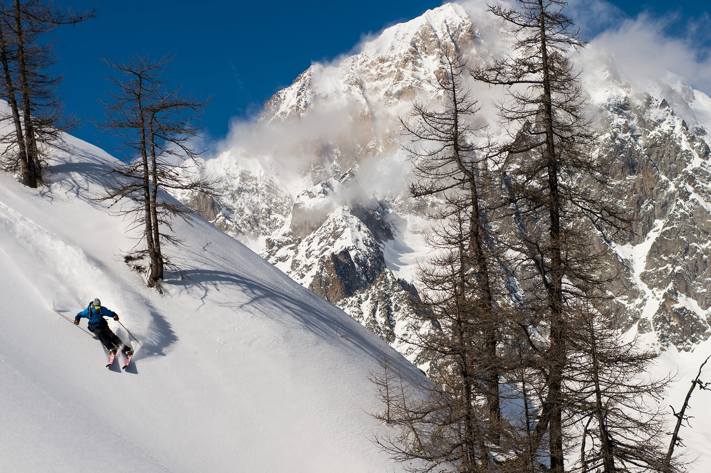 Skier powder turn in Italy
