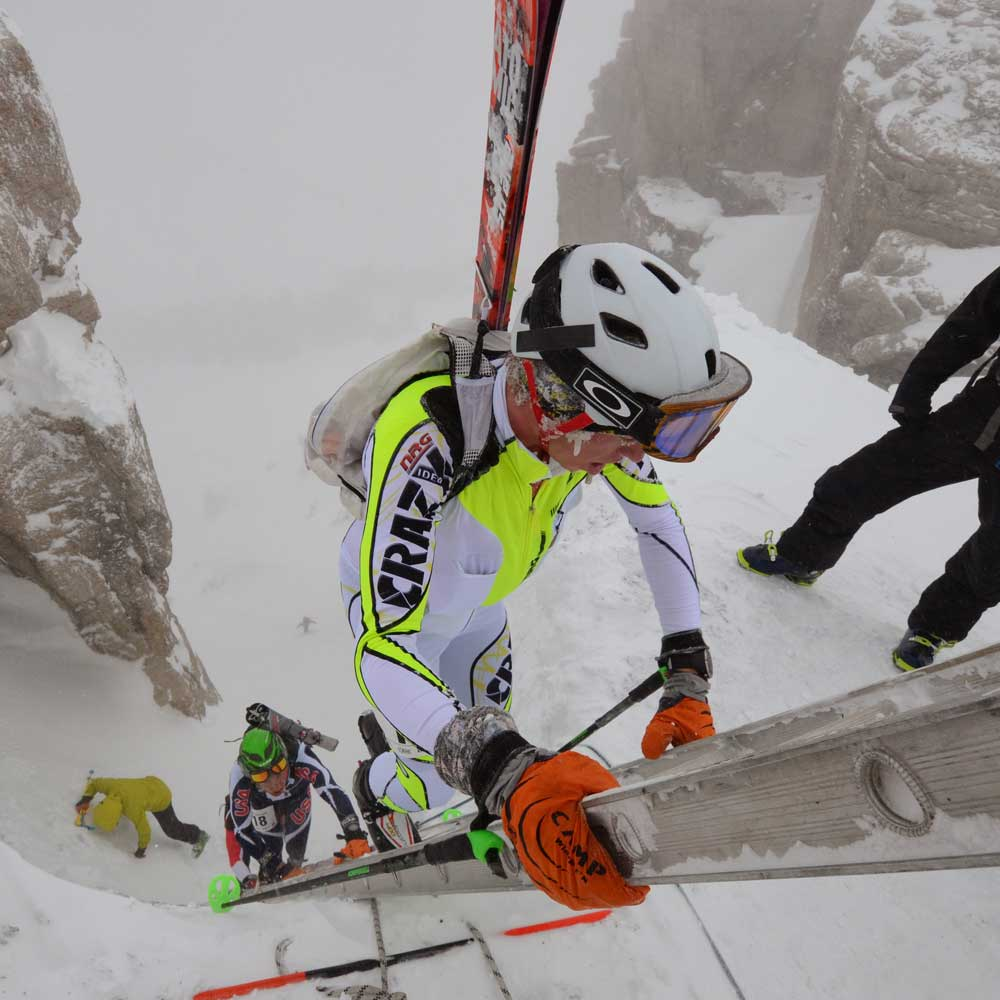 John Gaston climbing ladder during skimo race in Europe