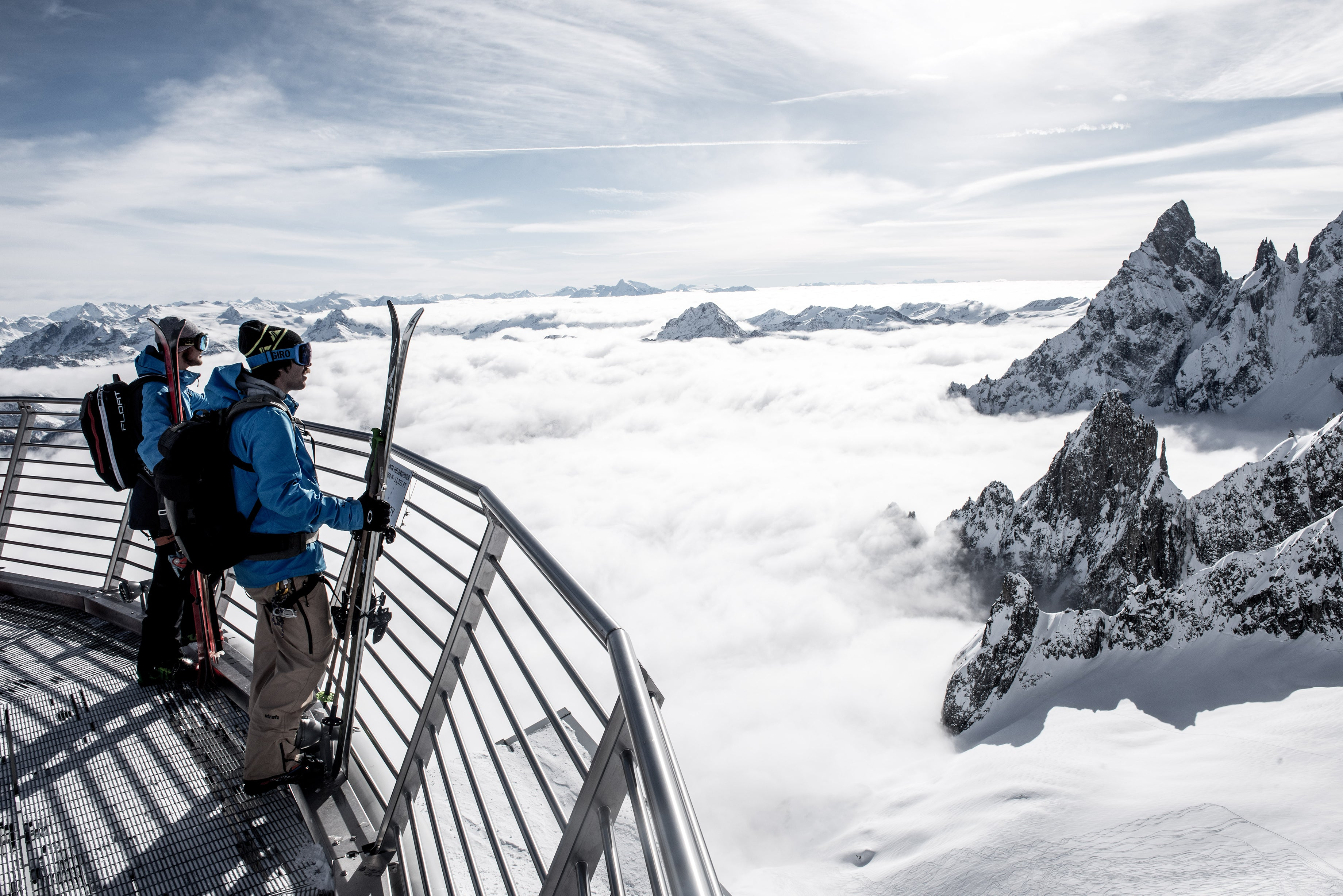 Skiers peer over abyss