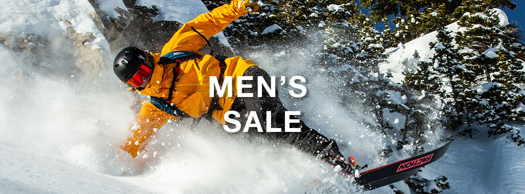 skier doing a nose butter with sale text