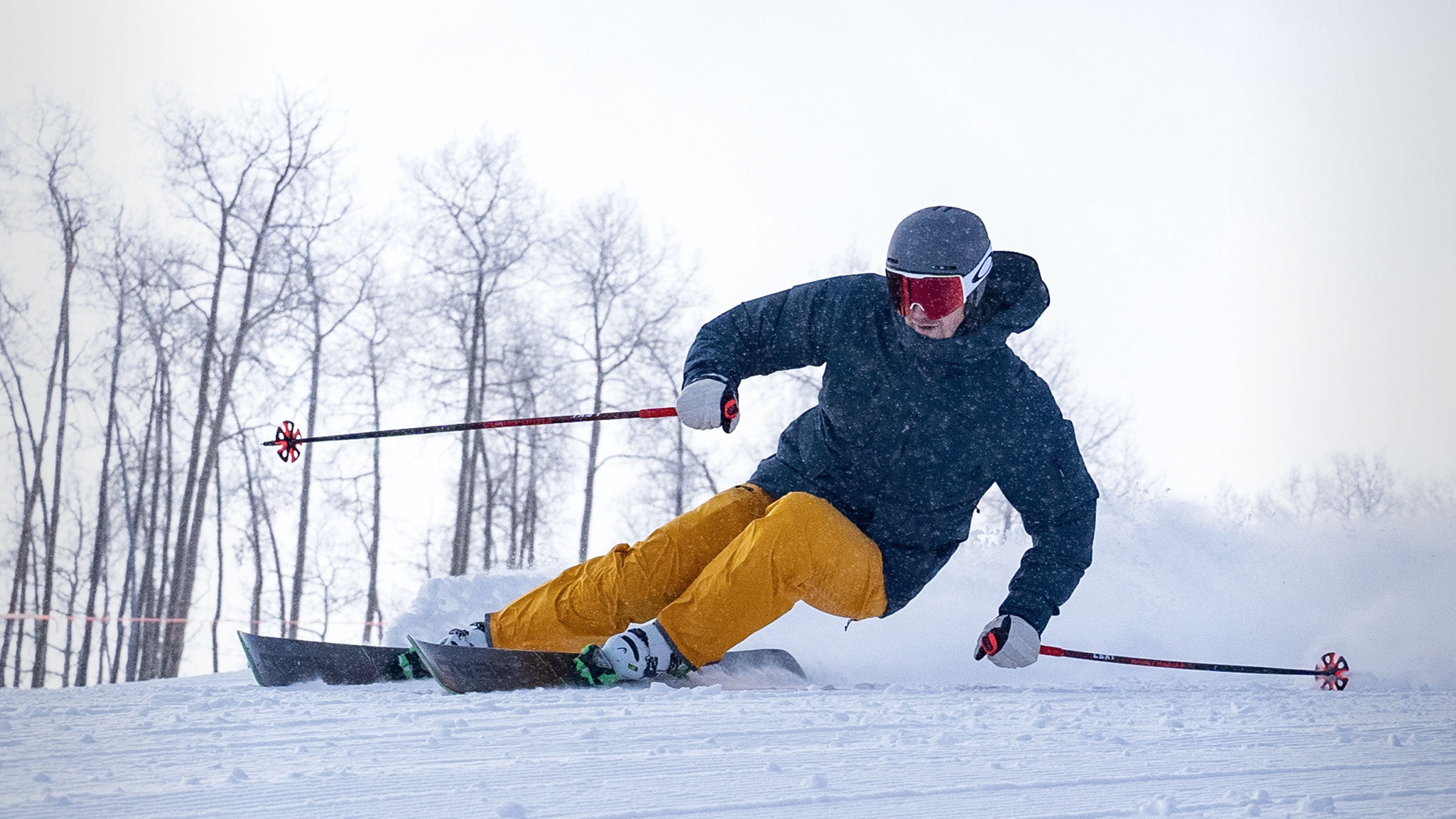 skier carving turn in turmeric capitol ski pant