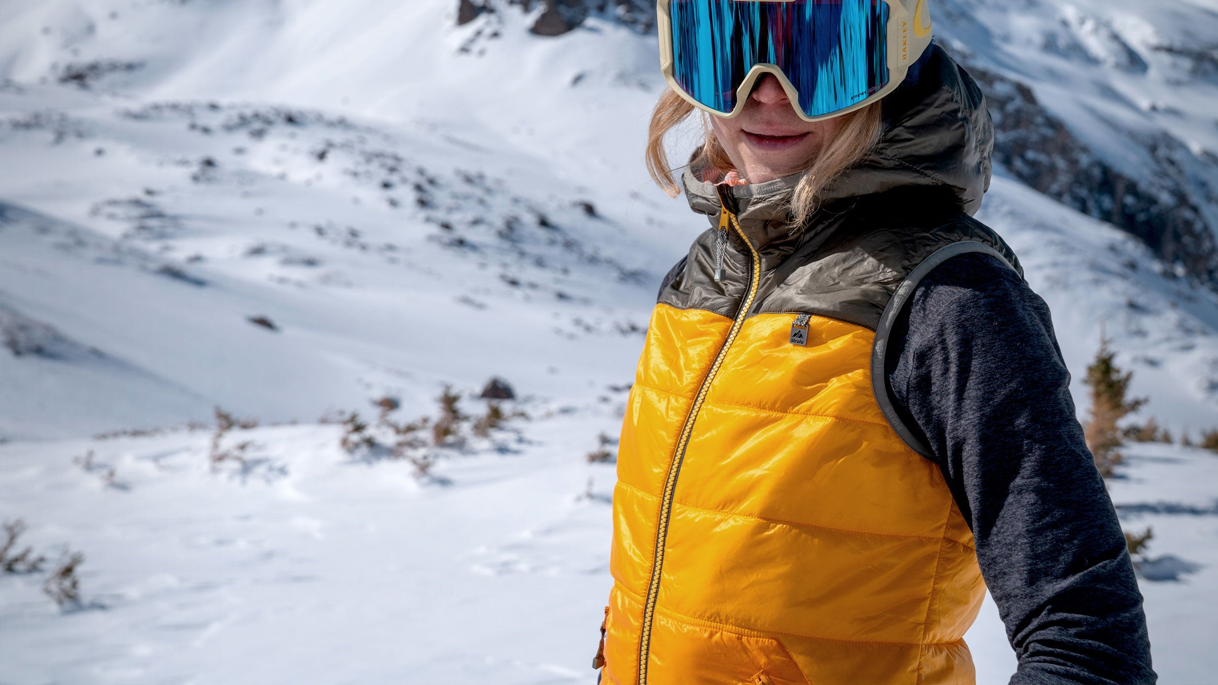 close-up of snowboarder in pique puffy vest
