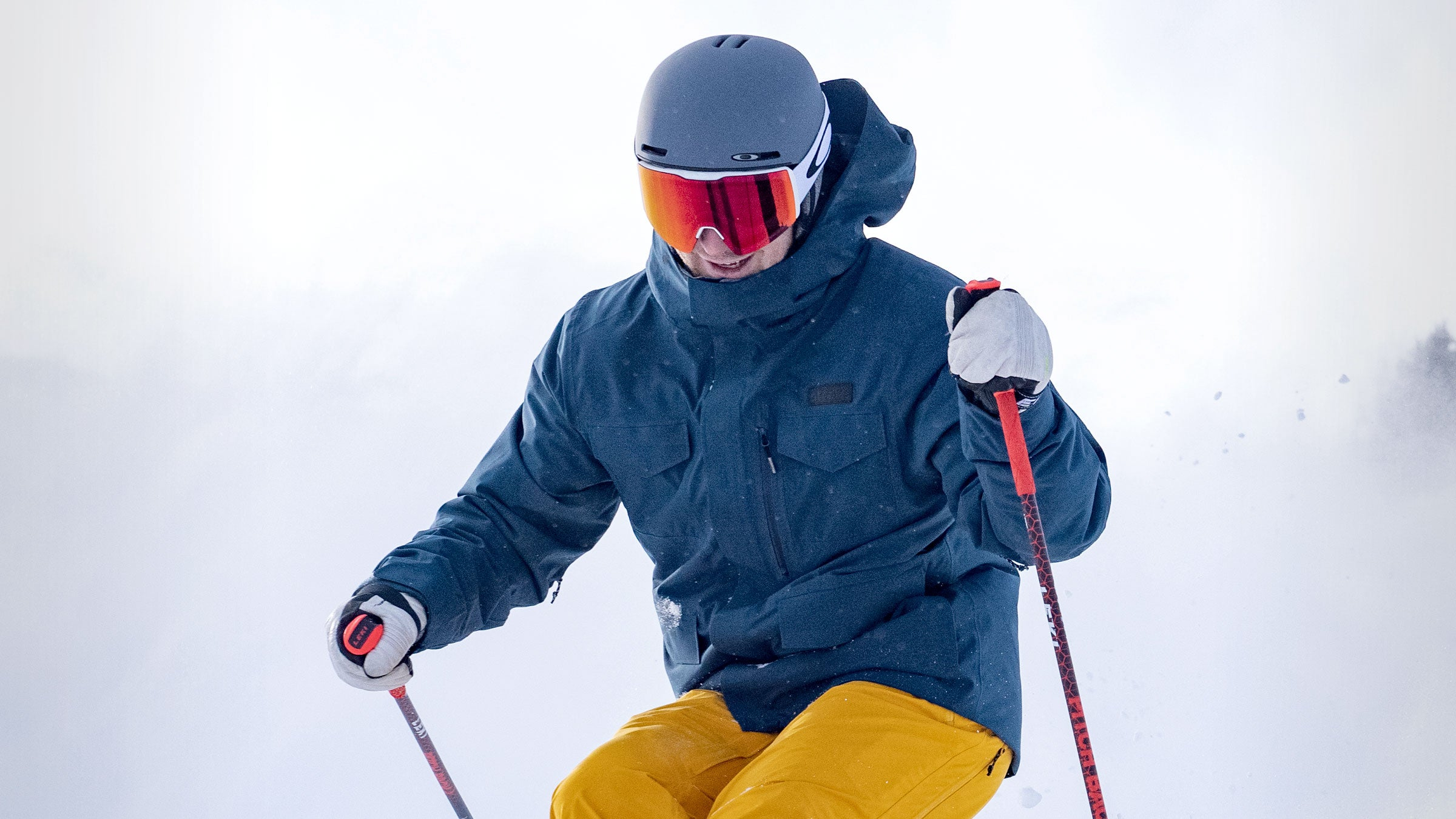 skier close-up in conundrum new navy ski jacket