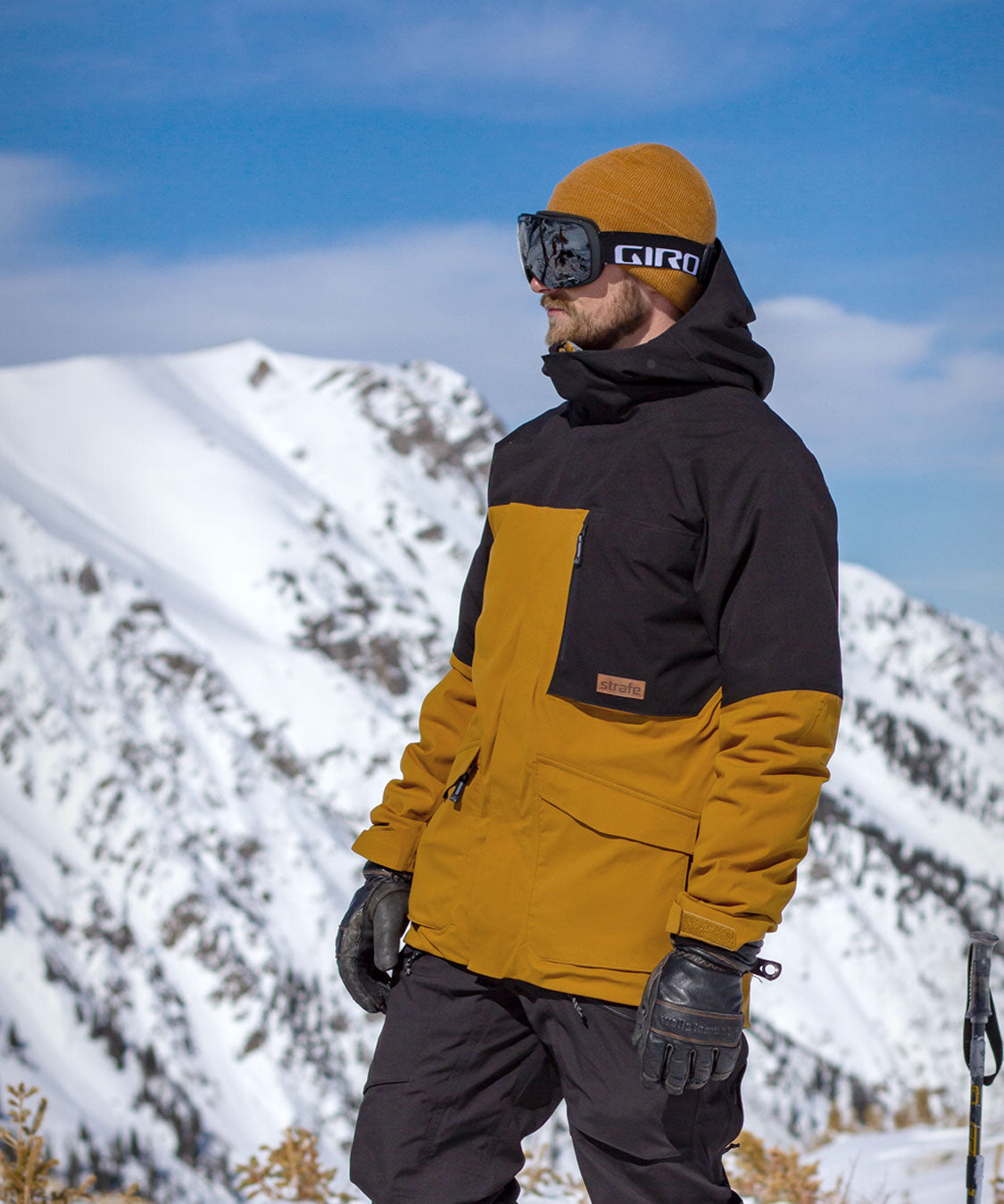 posing in the Hayden ski jacket in front of snowy mountains