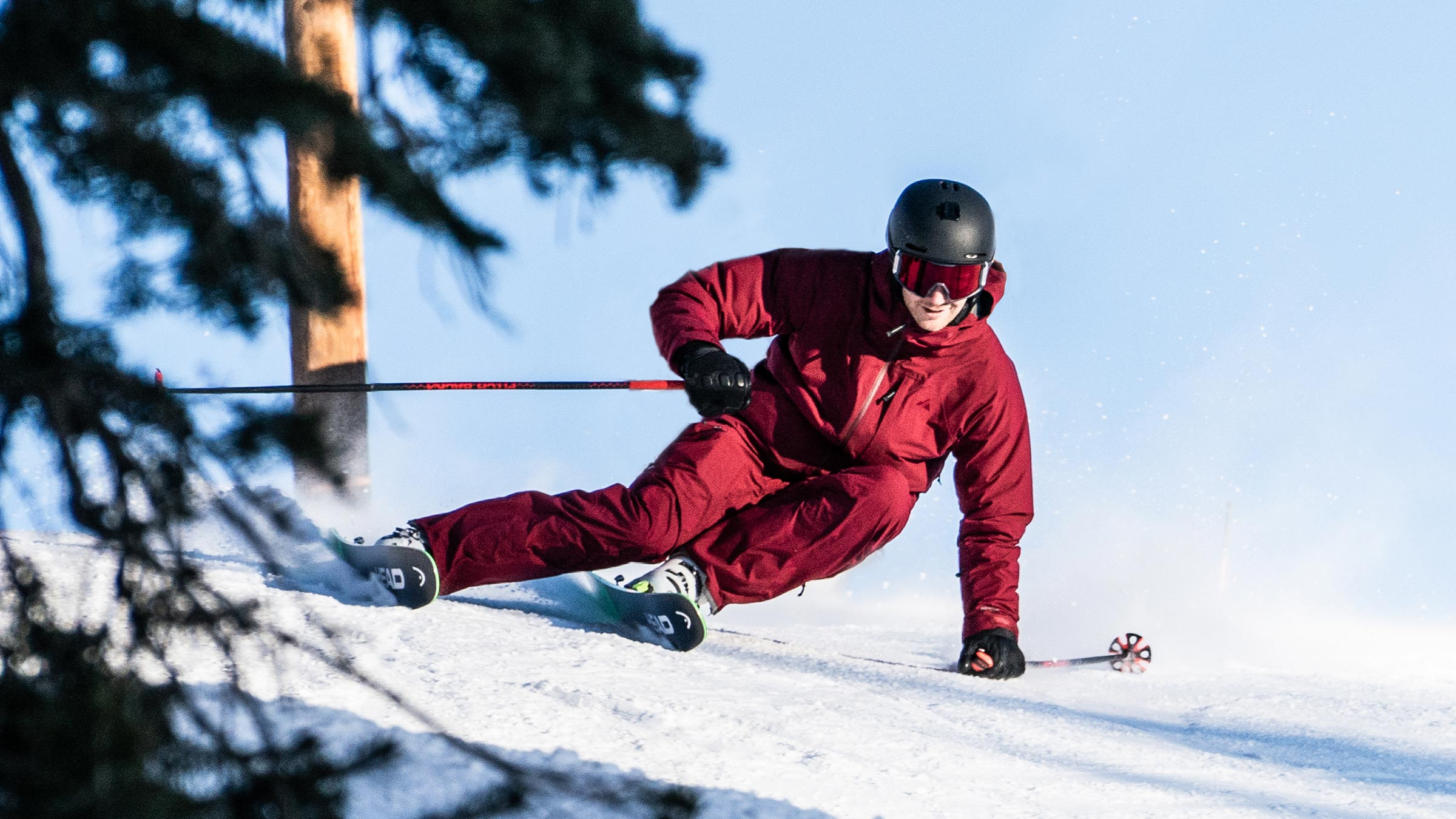 skier carving in ozone jacket