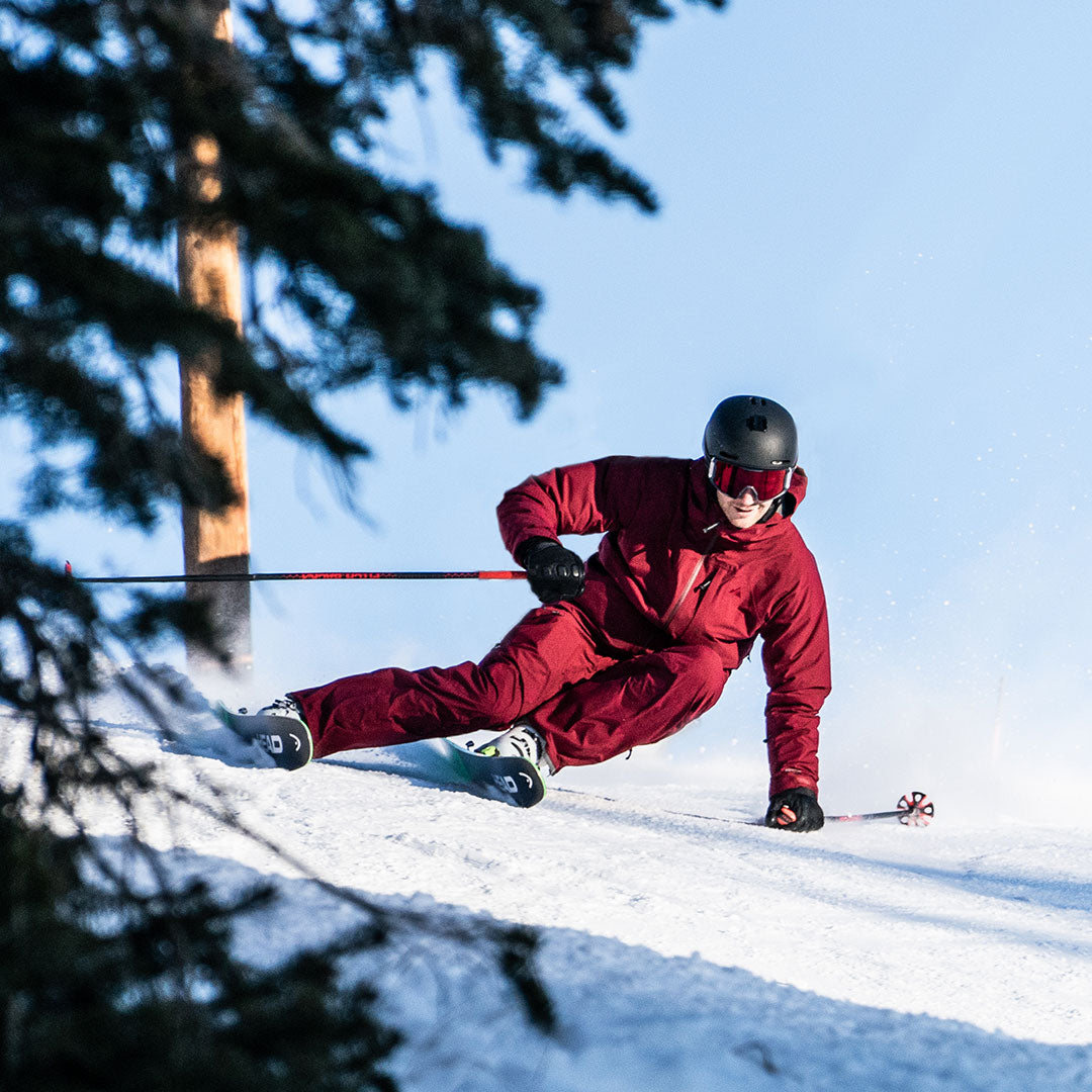 skier arcing a turn in pinot ozone jacket