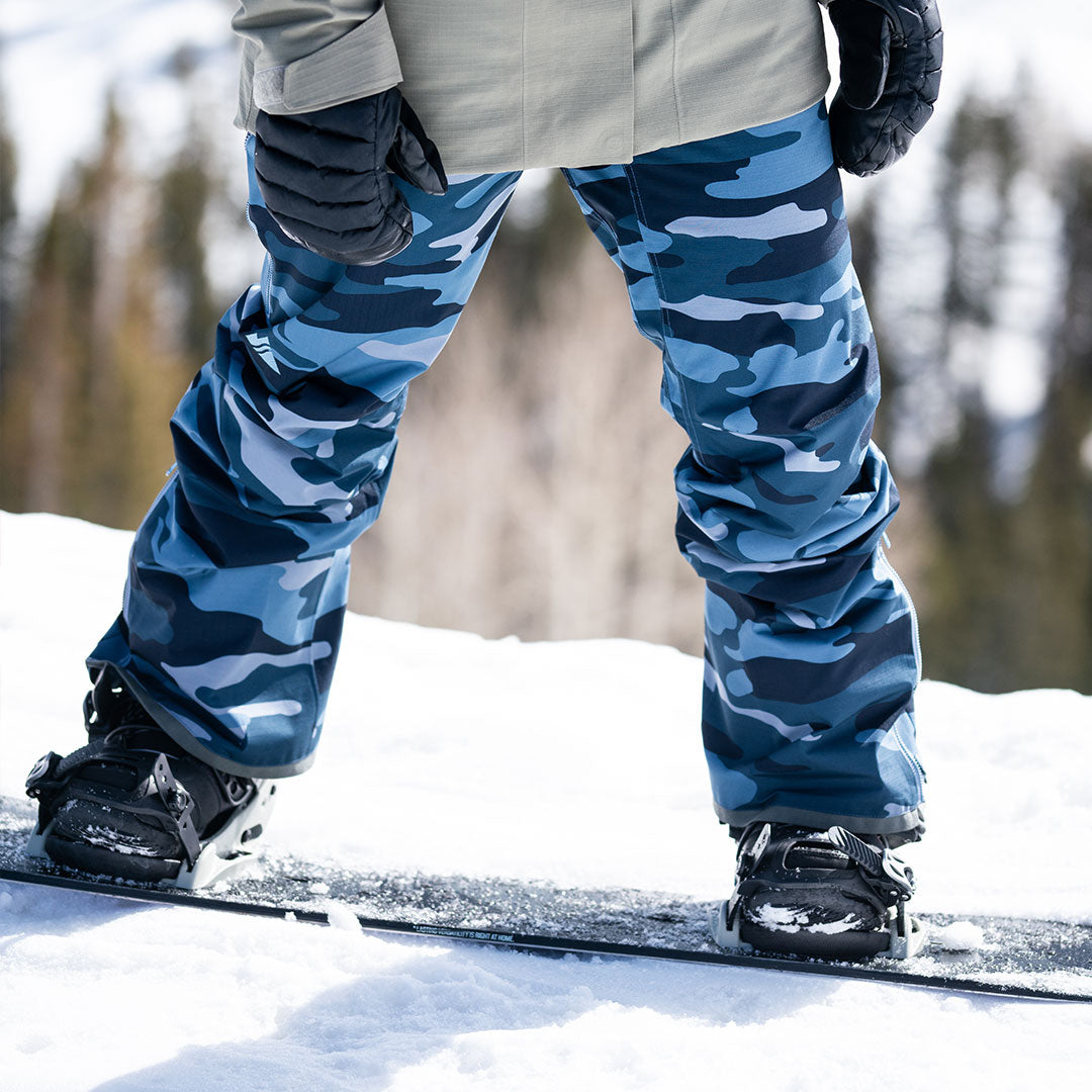 close-up of snowboarder wearing ocean camo pika pants