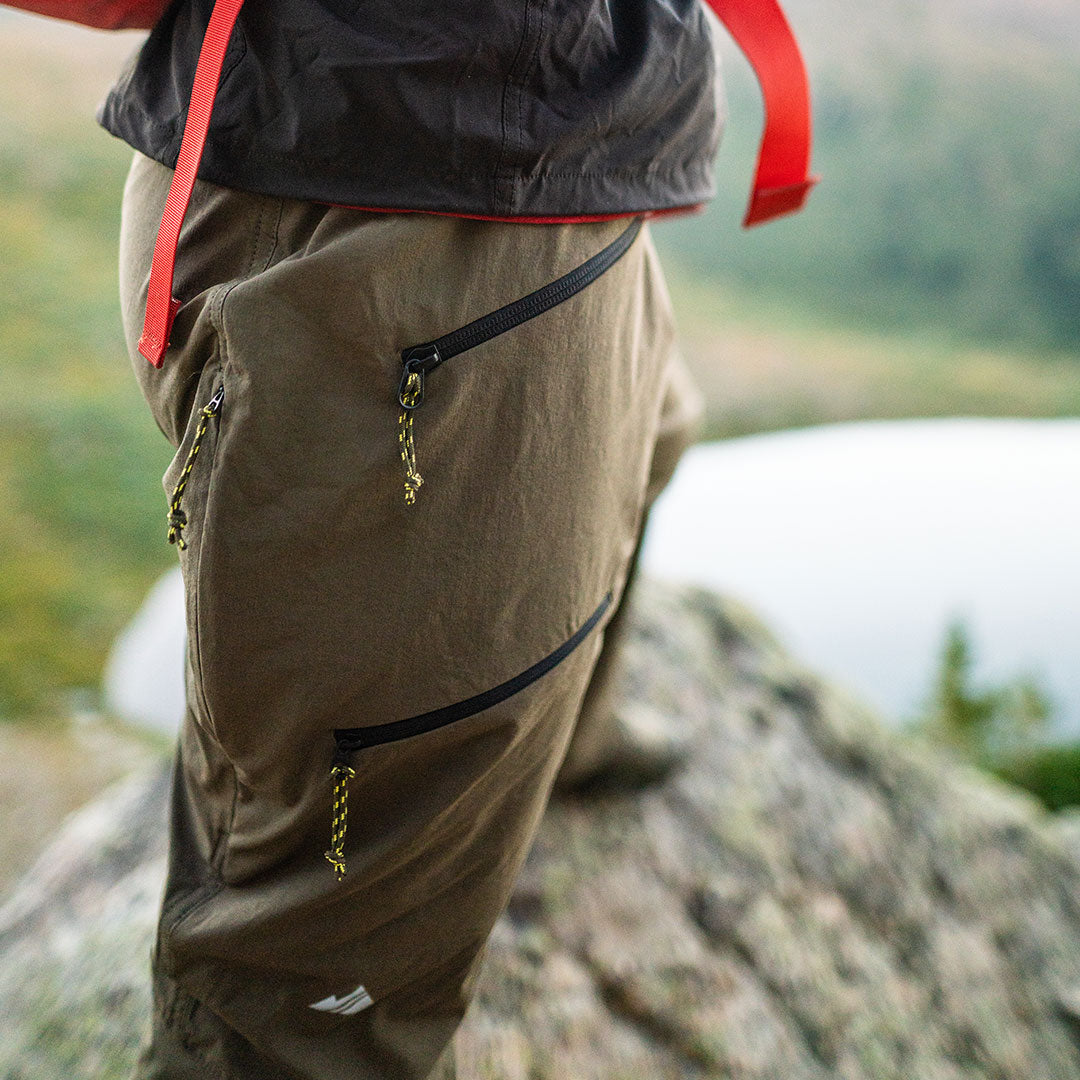 close-up of olive recon pant leg on fall hike