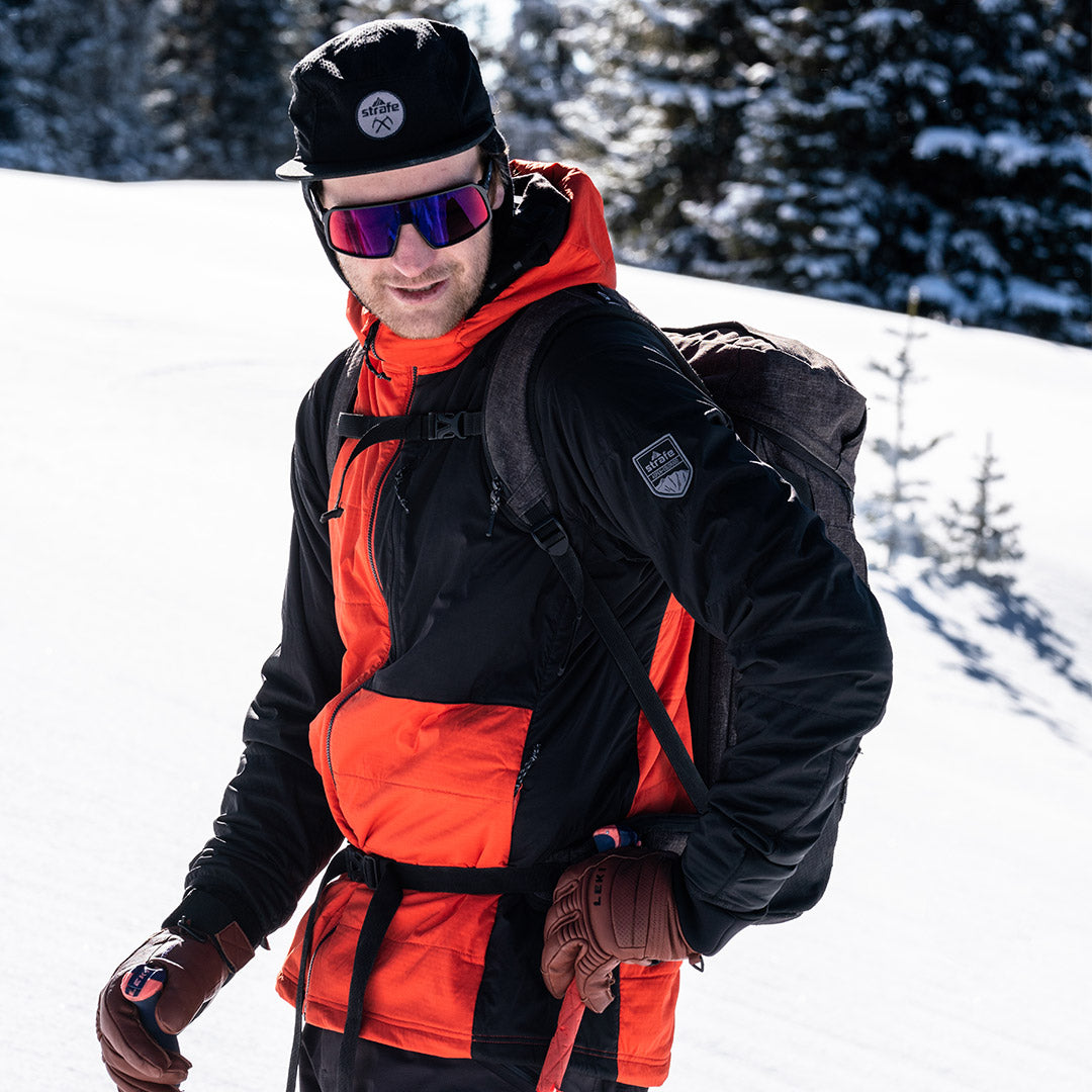 skier touring on Richmond ridge in the black and red alpha hooded insulator