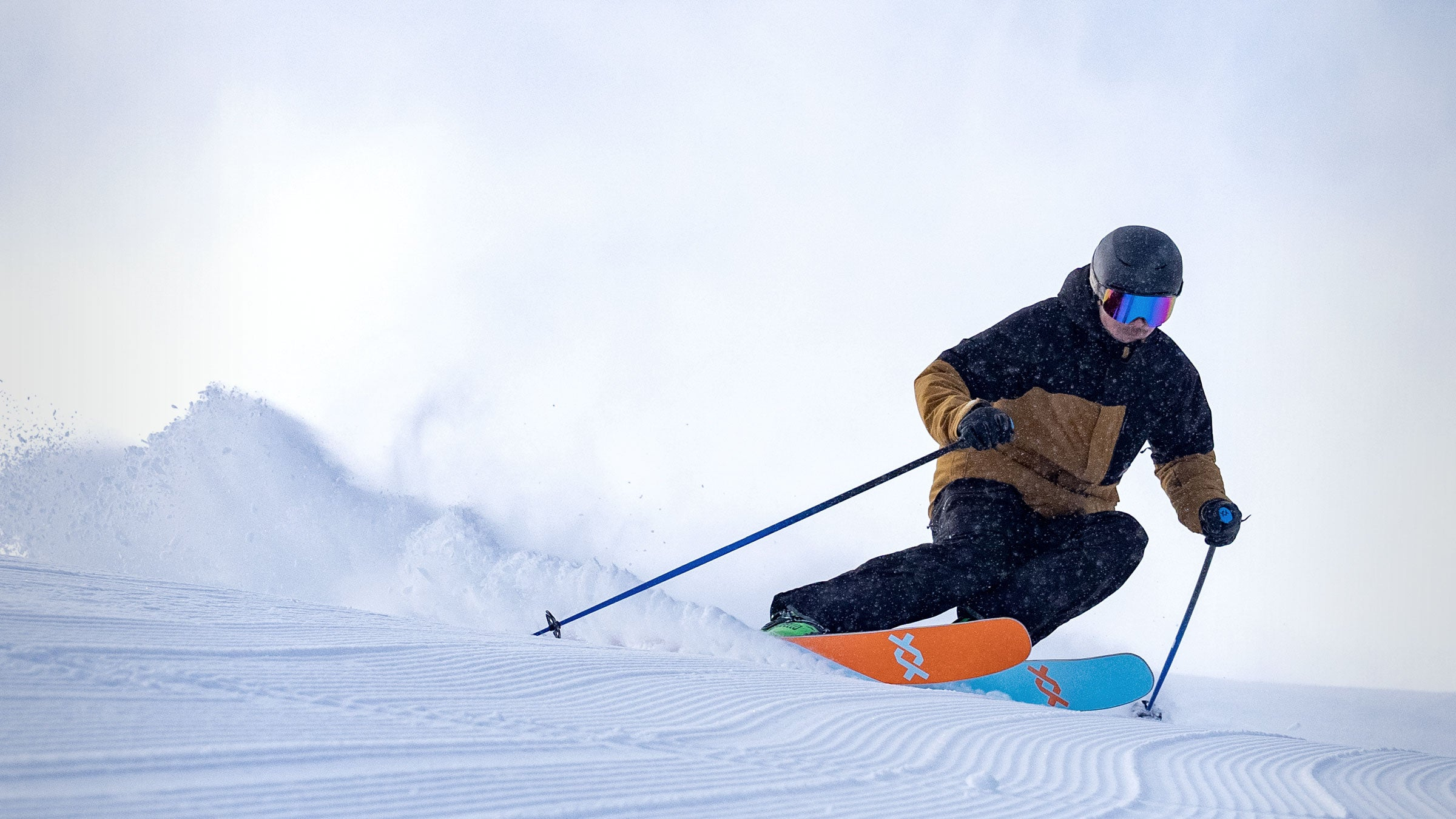 George Rodney carving a turn in the black summit ski pant