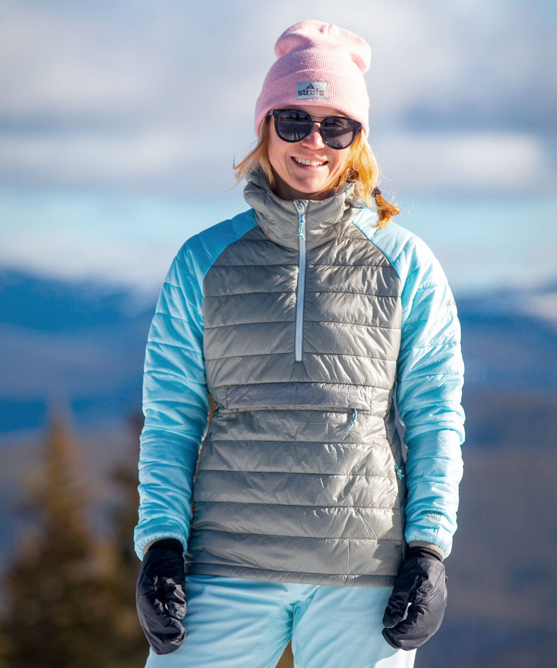 woman in aero pullover standing in snow