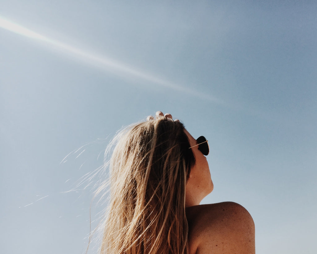 woman sunbathing on a cloudless day