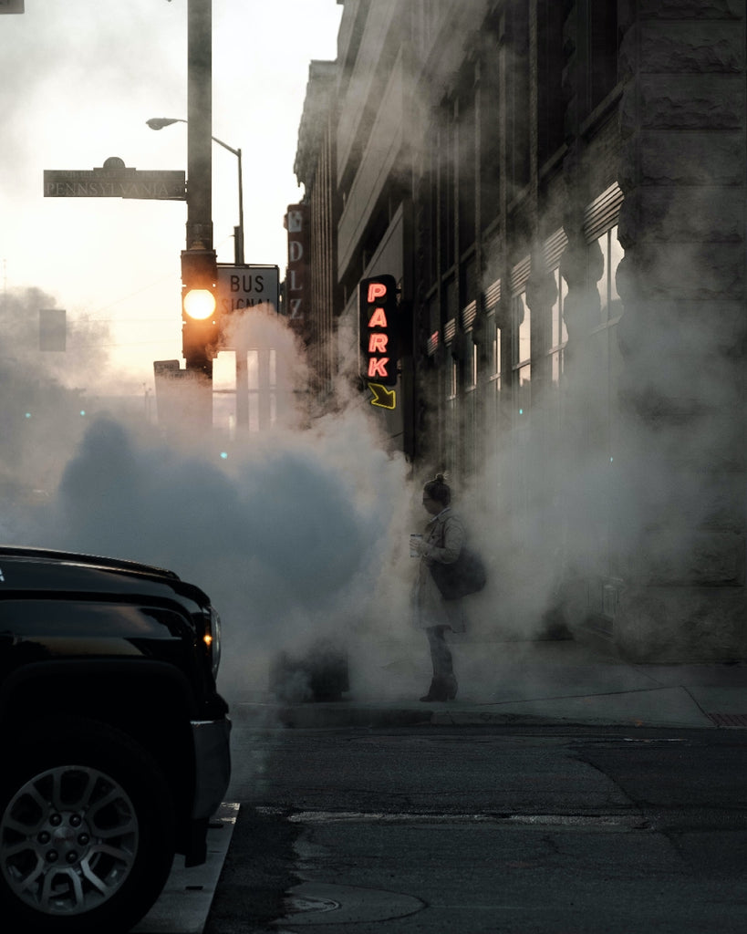 vehicle fumes and pollution on a city street
