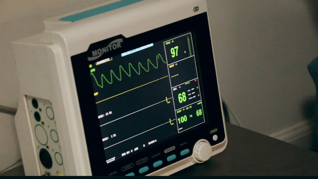 hospital machine showing heart rate